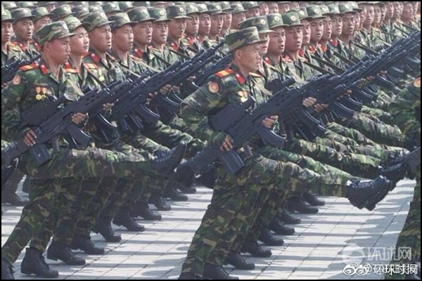 North Korea displaying their new small arm in the theme of a Objective Individual Combat Weapon.