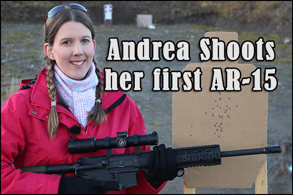Andrea showing her target from shooting her first AR-15.