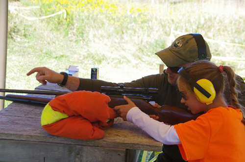 Teaching children responsible firearm handling.